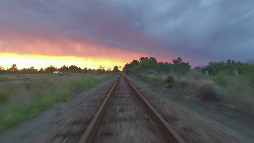 Aerial Shot Flying Low Over Train Tracks in Red Sunset | Shutterstock HD Video #18253027