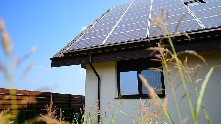 Renewable energy home with solar and thermal panels on roof | Shutterstock HD Video #18267850