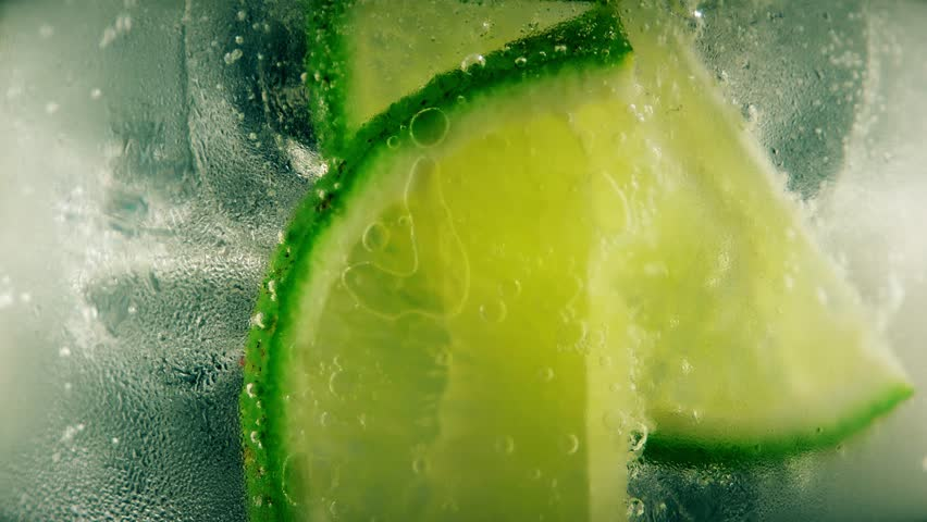Cold cocktail with lime, tonic and ice, closeup