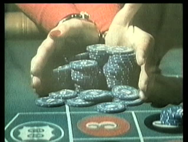 Close-up placing large bet at roulette table