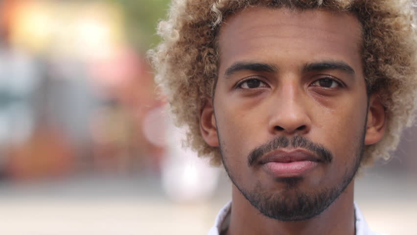 Young man in city face portrait smile  | Shutterstock HD Video #18302131