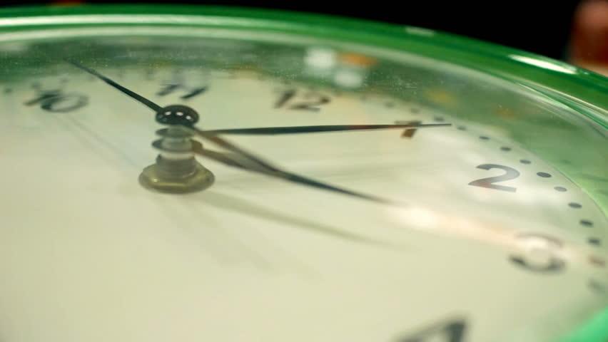 Office wall green clock close-up