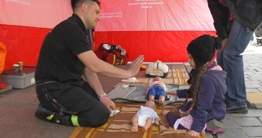 /not Relevant - Apr 23 2016: a Little Girl Tries to Understand Human Physiology. a Teacher on First Aid Helps Her in This. it Shows on Dummy How it is Necessary to Render the First Medical Aid. the