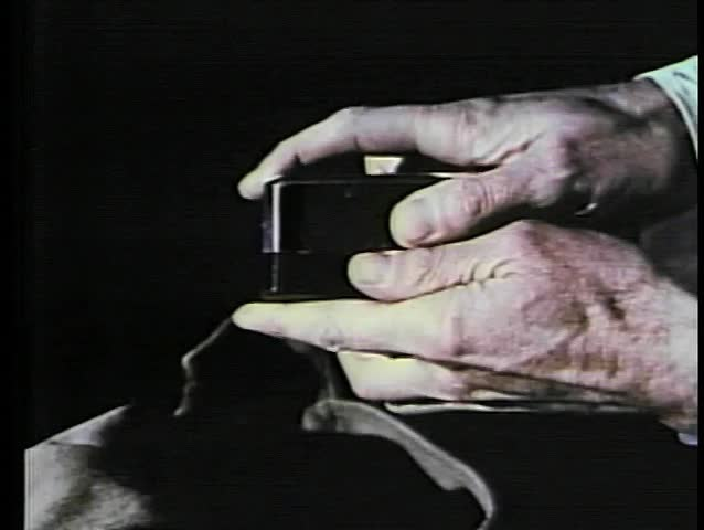 Close-up hands opening box containing electronics device