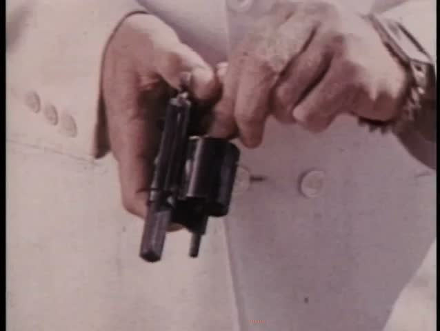 Close-up hands loading gun - SD stock video clip
