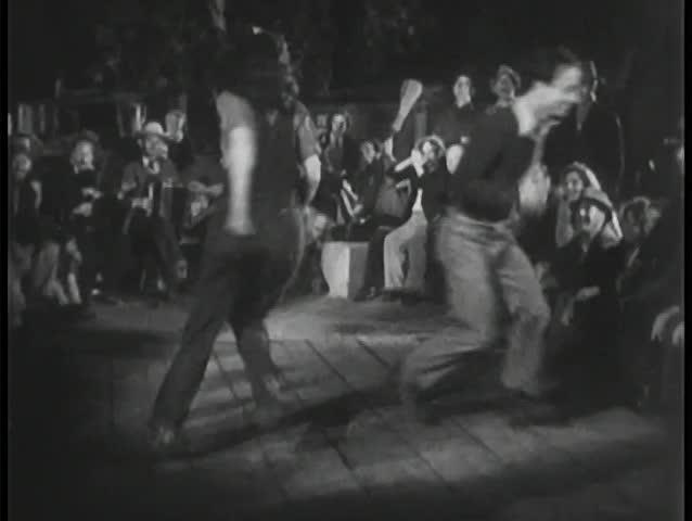 Crowd watching people dancing outdoors
