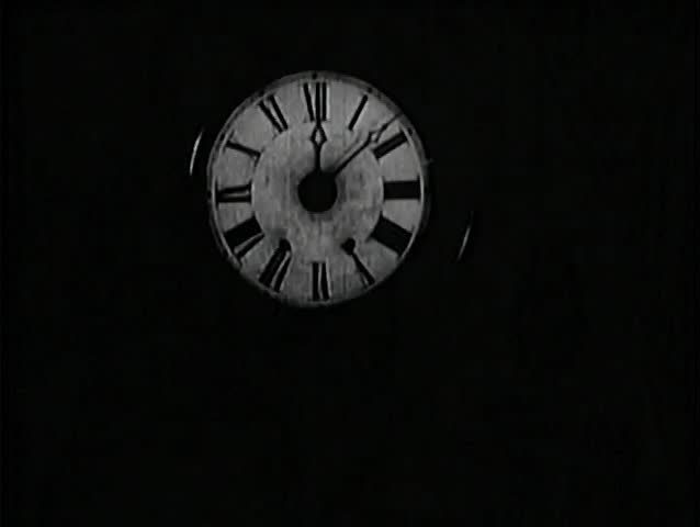 Close-up of wall clock at 12:08   Shutterstock HD Video #1842031