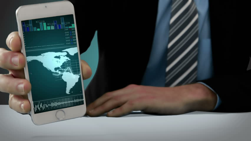 Close-up of hand of showing mobile phone with virtual digital interface | Shutterstock HD Video #18460846