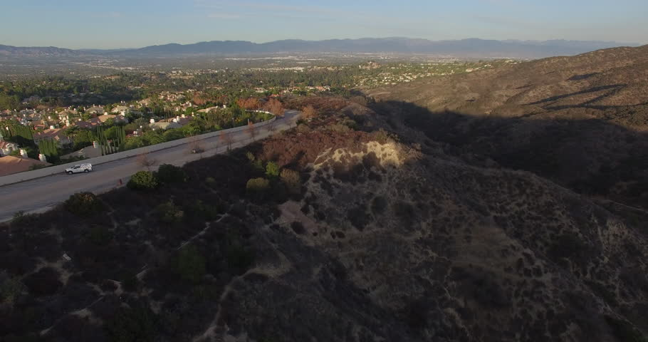 Car Driving on the outskirts of a neighborhood Aerial | Shutterstock HD Video #18466705