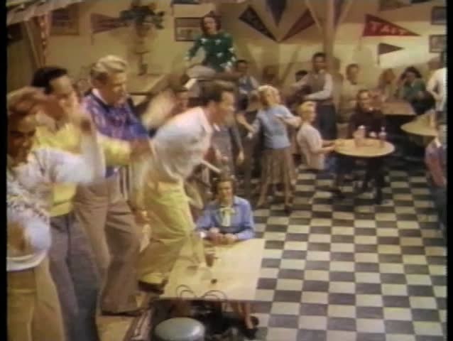 College students dancing in cafeteria