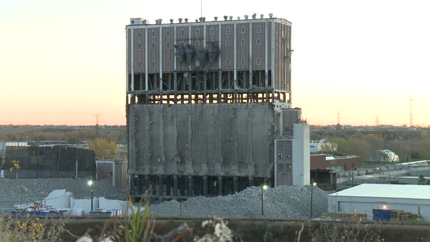 Building implosion wide shot