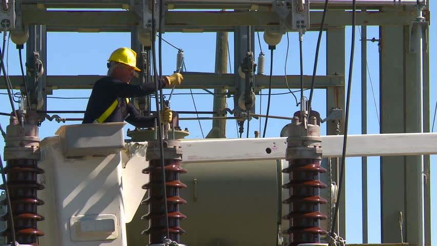 electrical worker on substation zoom