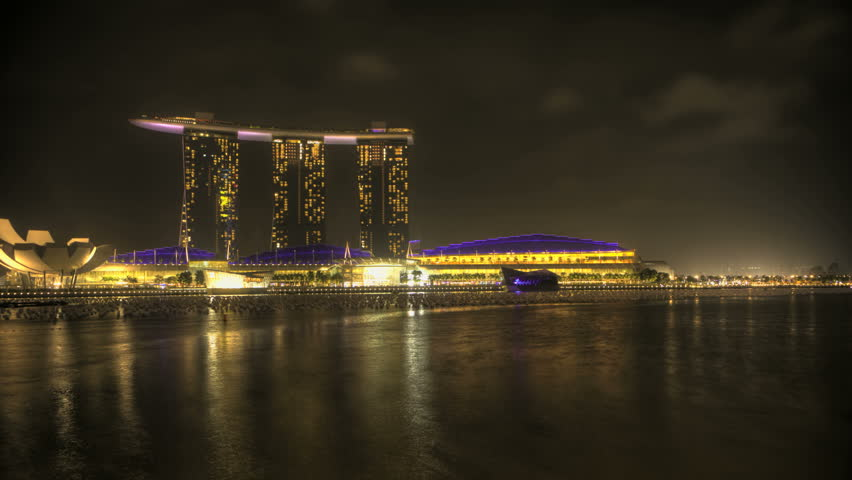 Timelapse Singapore Marina Bay at night with a view of the Opera and Skyscrapers