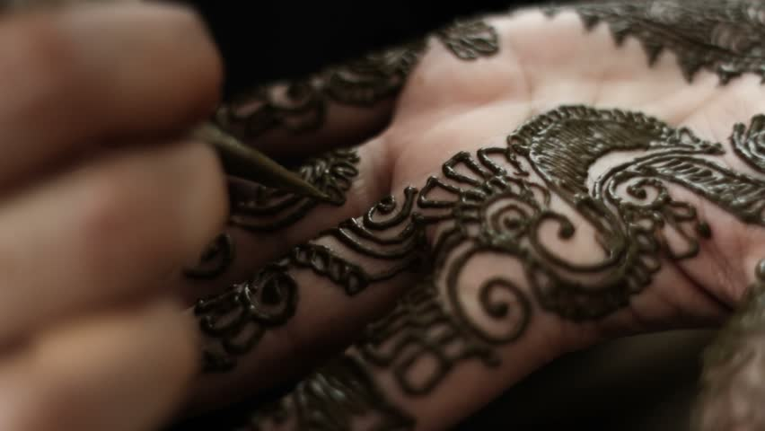 Close up on henna being applied - HD stock footage clip