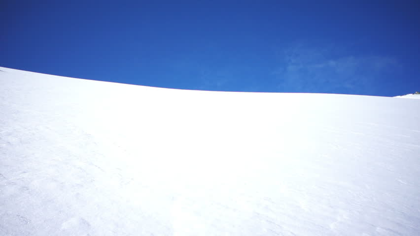 skier skiing in fresh powder snow in slow motion