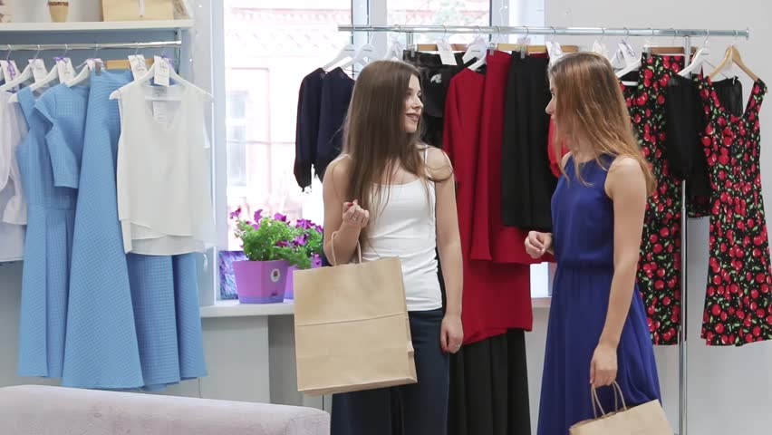 Two girls talking and shopping | Shutterstock HD Video #18965530