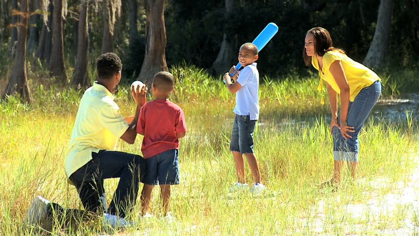 African American family playing together in the outdoor ...