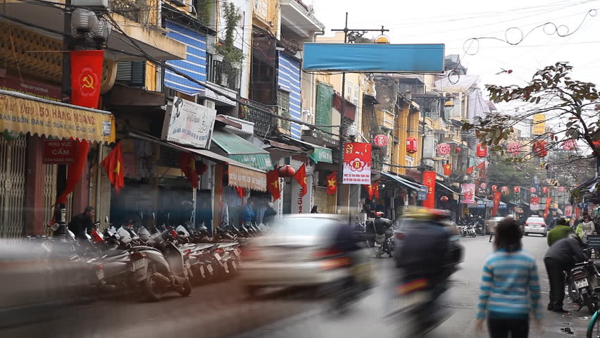 HANOI, VIETNAM - FEBRUARY 15, 2011 Time Lapse of The Bustling Street Scene Old Town, Motorcycles, Cars Traffic | Shutterstock HD Video #1913419