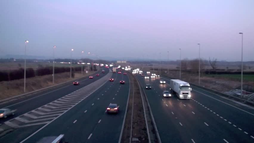Motorway traffic at dusk speeding past - HD stock video clip