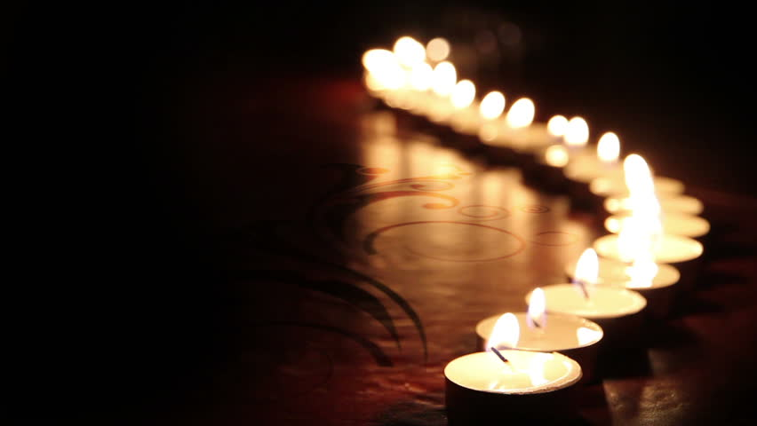 little candles lined up light up one by one - HD stock video clip