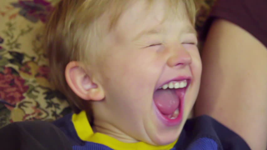 Close up on adorable little boy as he yells, laughs, and screams in joy and excitement | Shutterstock HD Video #19152397