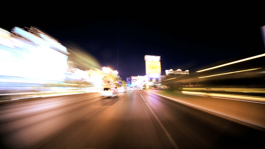 Timelapse point of view of traffic and neon lights on the streets of Las Vegas at night