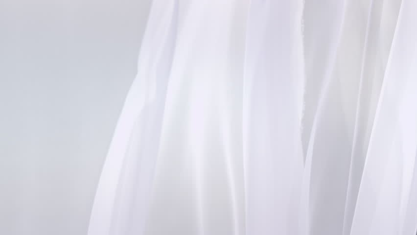 Sheer white curtains blowing in the wind 4k stock video clip
