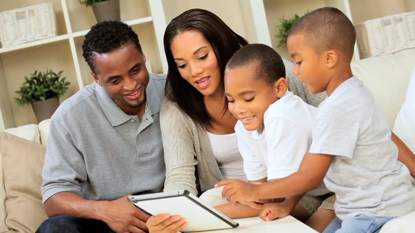Young Ethnic Family Talking To Family Via Video Web Chat ...