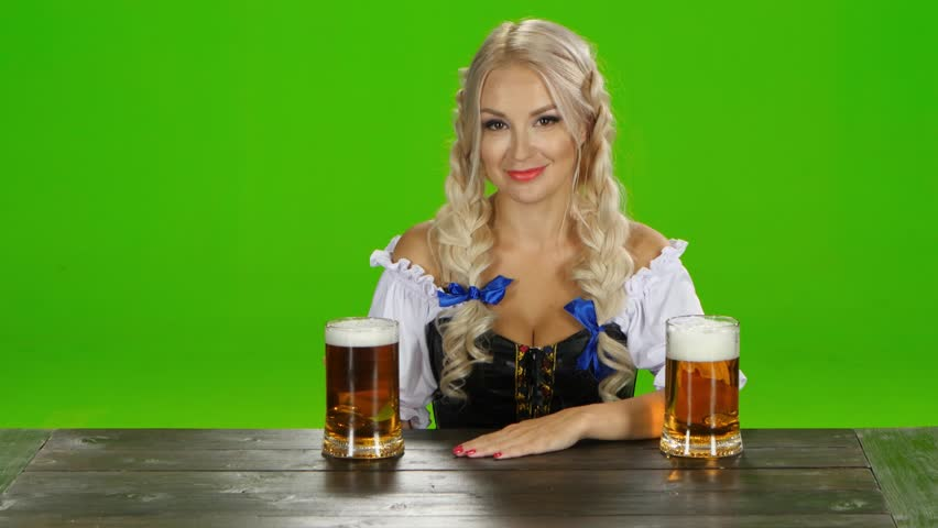 Bavarian girl sitting at a table with two glasses of beer. Green screen | Shutterstock HD Video #19217251