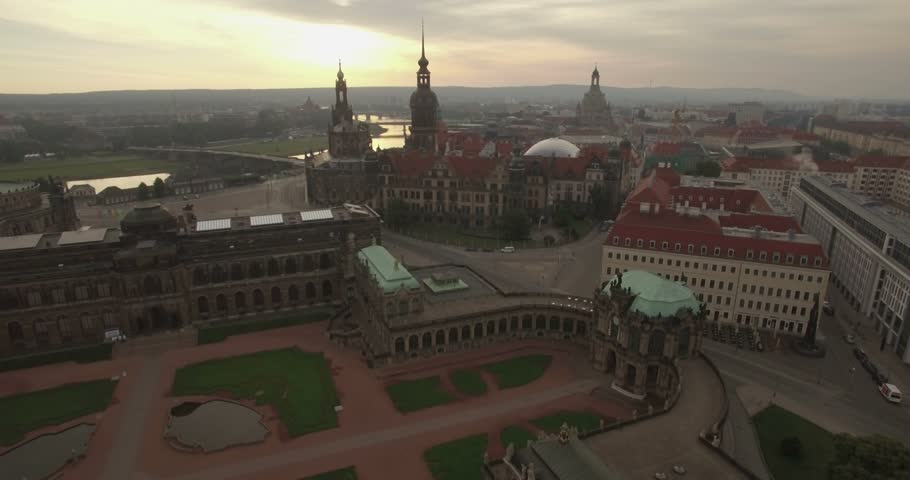 Aerial camera descends over the Zwinger Palace with the Dresden skyline behind. Shot on a cloudy morning at dawn | Shutterstock HD Video #19254376