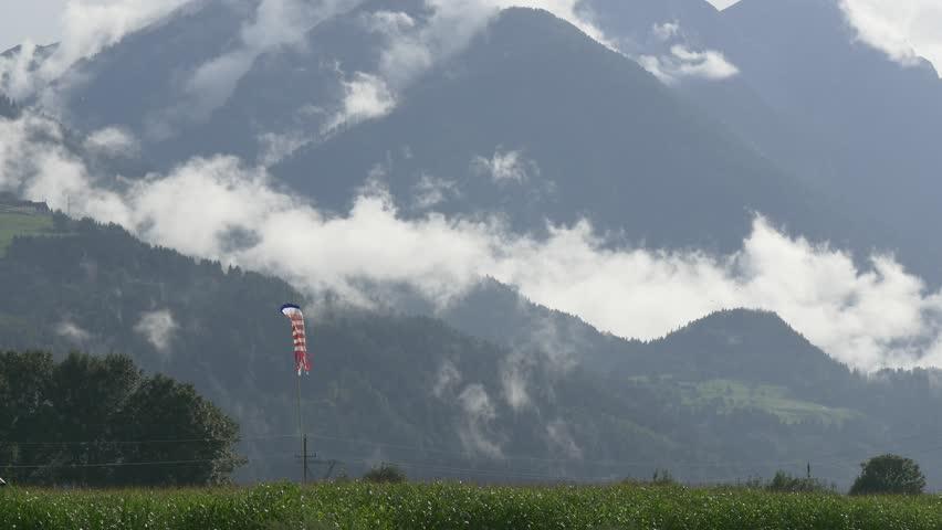 Sparkling drops of light rain, clouds run along mountain gorges   Shutterstock HD Video #19307998