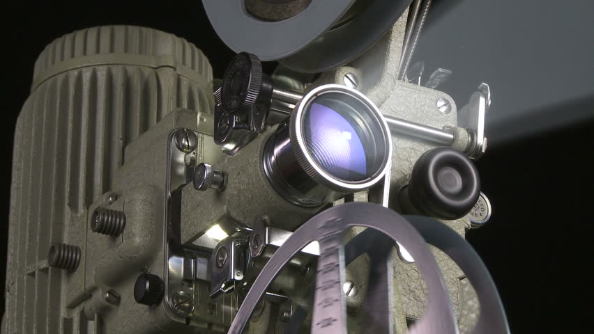Medium low angle shot of 16mm film projector at start up - HD stock video clip
