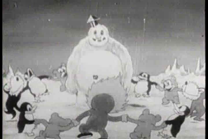An Eskimo and his animal friends dance happily around the snowman they built, until it comes to life and scares them in this cartoon from 1933. (1930s)