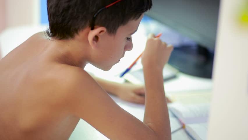 Teenage boy doing homework using a cell phone. natural video | Shutterstock HD Video #19417069
