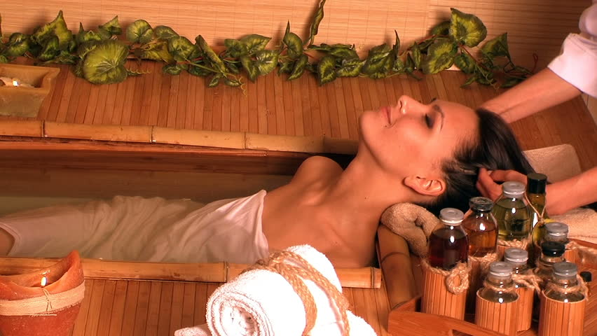 Young woman getting massage in bamboo spa. - HD stock footage clip