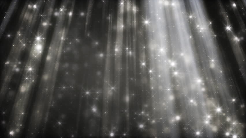 black and white background glittering particles in light beams loop