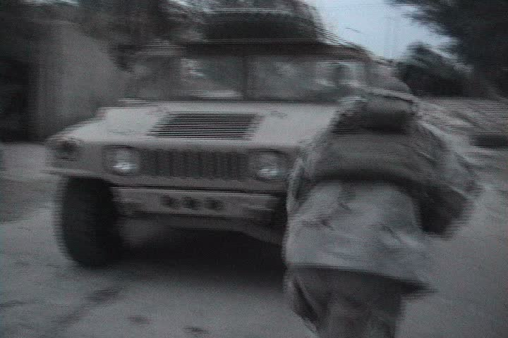 BAGHDAD, IRAQ - CIRCA 11/25/03: U.S. Soldiers practice reacting to an ambush in soft skin humvees. - SD stock footage clip
