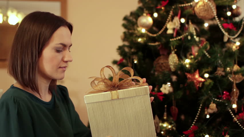 Amazed woman looking at magical christmas gift in the box | Shutterstock HD Video #1956907