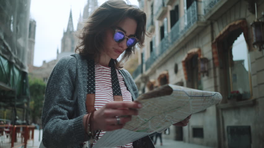 Close-up shot of young attractive hipster girl standing at the city center and looking Barcelona landmarks on the map, slow motion, urban scene, tourism and travel concept | Shutterstock HD Video #19651420