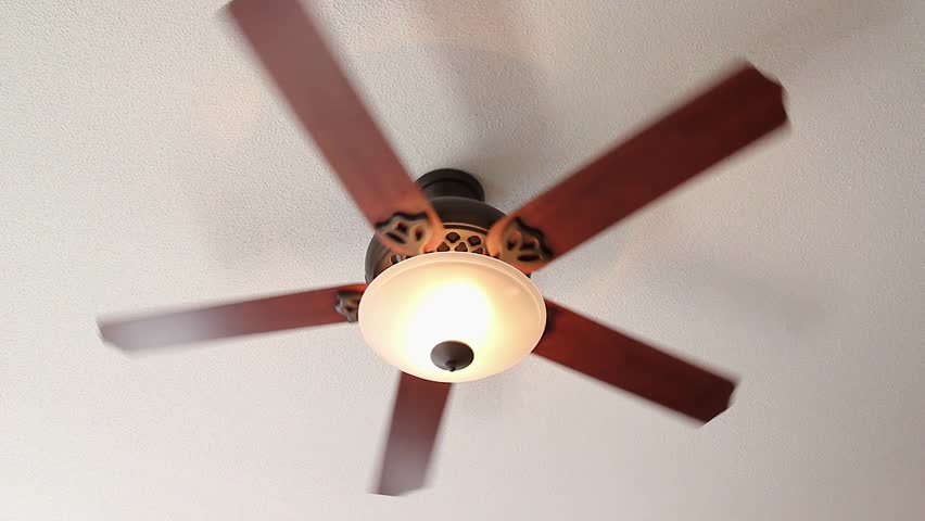 a ceiling fan spins on high setting with light stock footage video 1967911 shutterstock. Black Bedroom Furniture Sets. Home Design Ideas