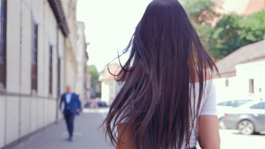 Young girl is checking up boy she passes by on the street. | Shutterstock HD Video #19690894