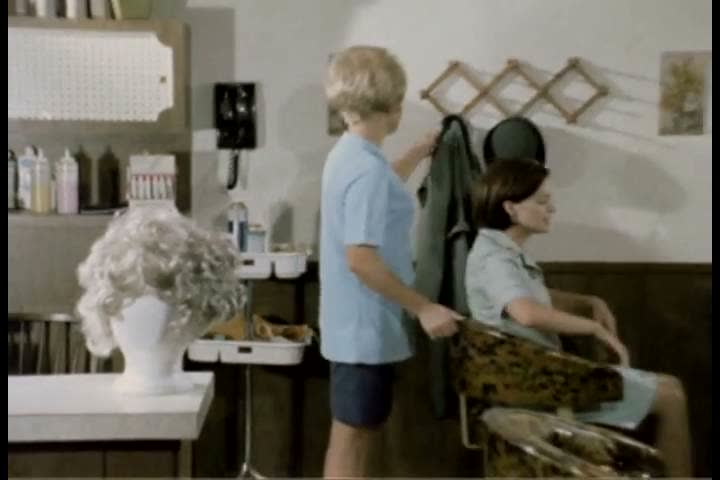 A WAC visits a cosmetician for a consultation in 1971. (1970s) - SD stock footage clip