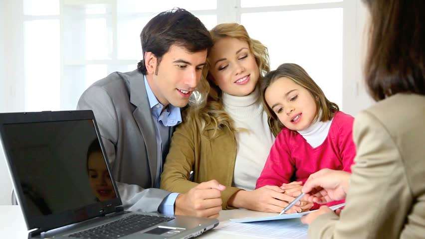 Family signing real-estate contract - HD stock footage clip