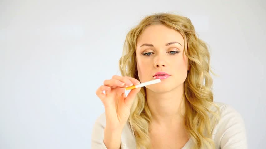 Beautiful blond woman deciding to quit smoking - HD stock video clip