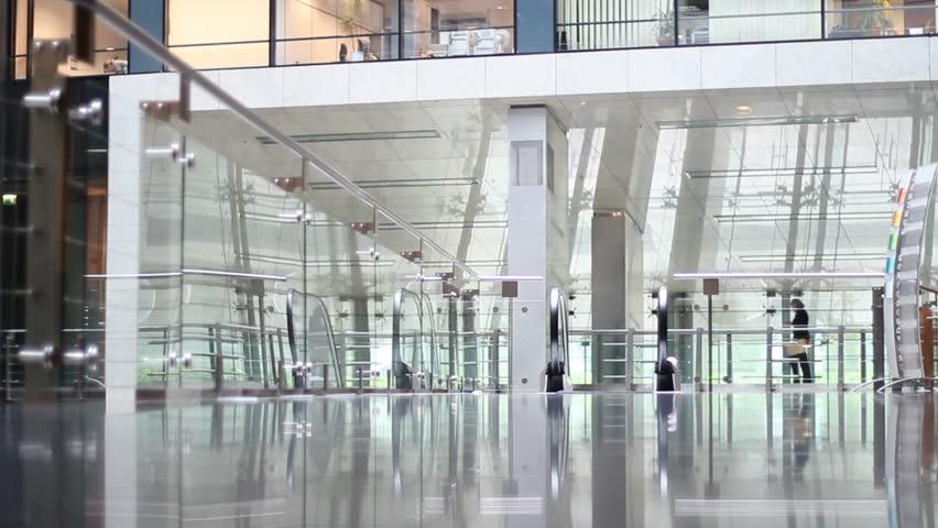 Businesswoman walkis through empty office building