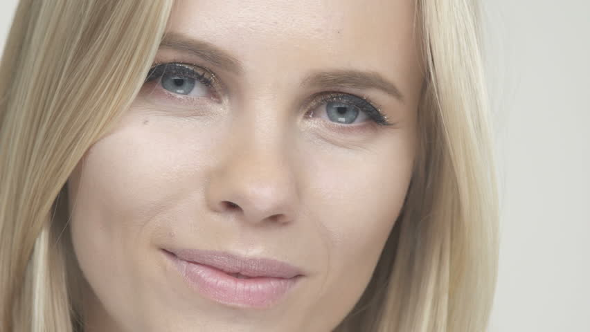 Face of cheerful smiling young beautiful blonde woman looking at camera | Shutterstock HD Video #19787329