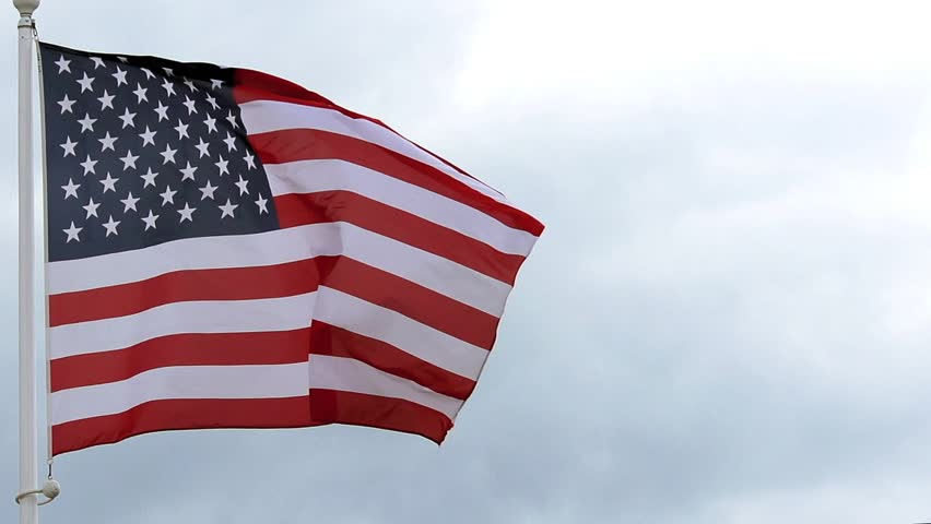 American Flag Waving Against Blue Sky. American Flag ...