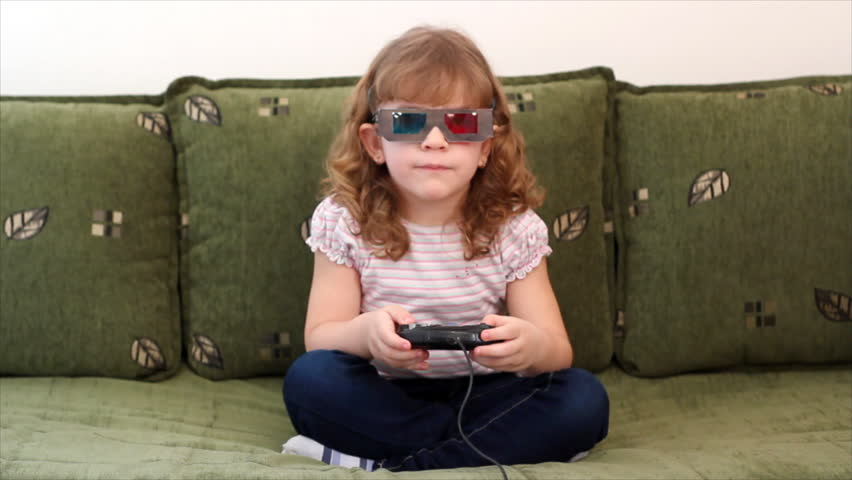 little girl with 3d glasses play video game - HD stock footage clip