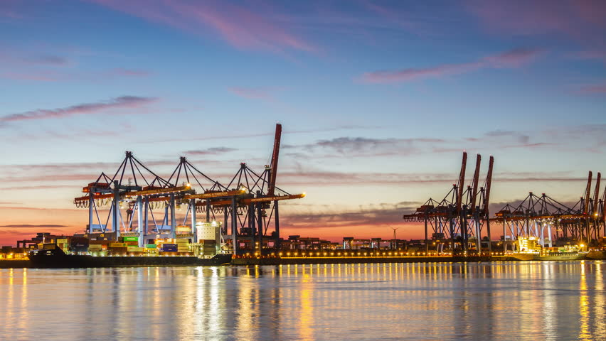HAMBURG, GERMANY  September 9, 2016: Harbor container ship terminal in evening timelapse Illuminated Hamburg container terminal with clouds on a sky time lapse   Shutterstock HD Video #19854262