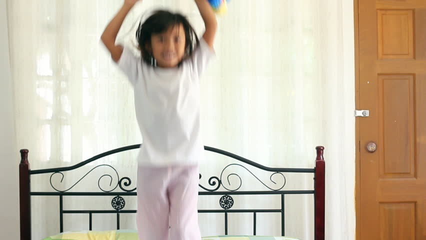 Happy child jumping on bed. - HD stock footage clip